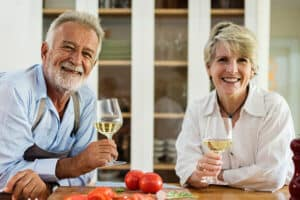 An older active adult couple enjoying their drinks.