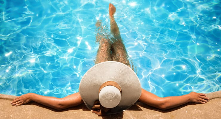 A woman relaxing at a boca raton swimming pool.