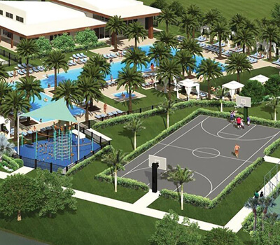 Clubhouse near single family homes with recreational amenities including a basketball court, a playground, and a swimming pool.