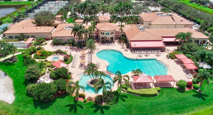 An aerial view of a valencia falls property. Large square footage and contains a spacious swimming pool
