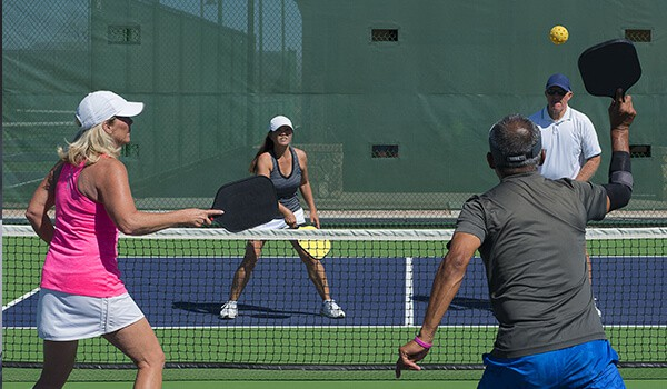 A game of pickleball being played in the Valencia Homes community.
